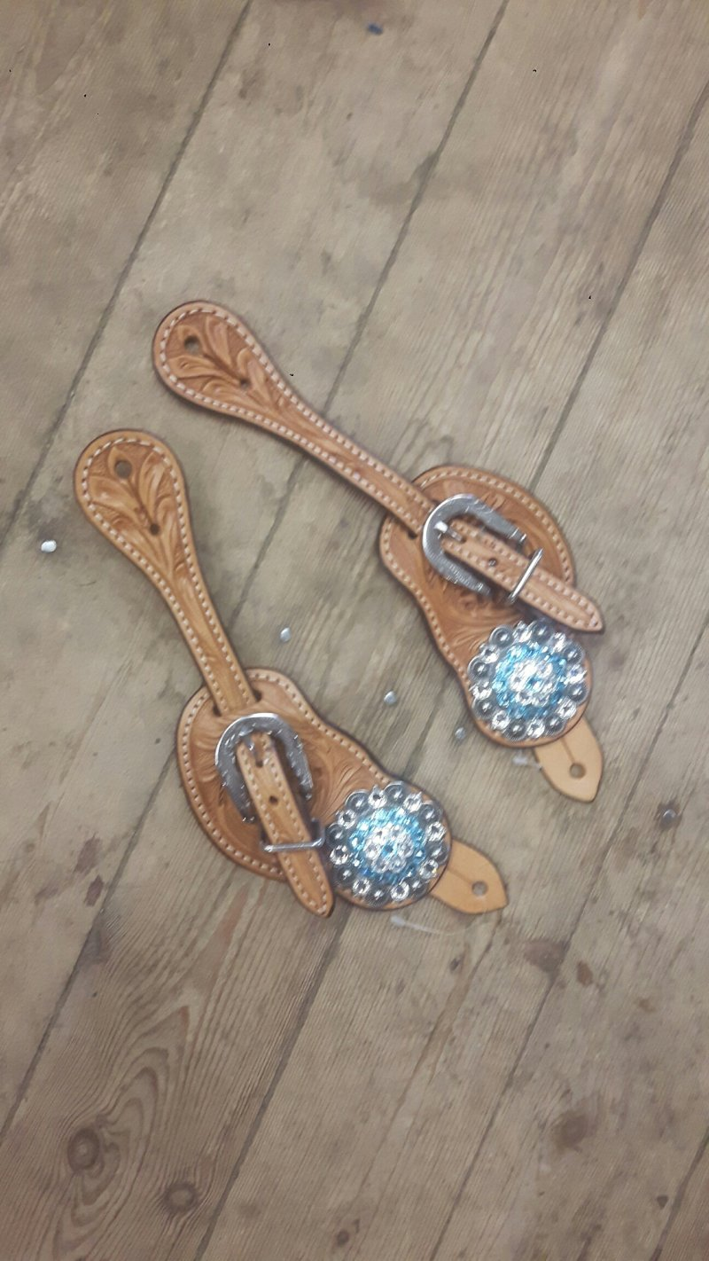 Natural spur staps with light blue colored conchos